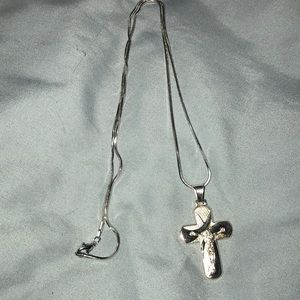 Brand new Sterling silver cross with 19 inch chain